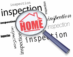 bigstock_Home_Inspection_Magnifying_G_69600921